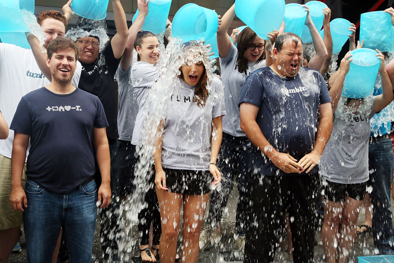 Employees of Tumblr take the ALS Ice Bucket Challenge. (Photo by Astrid Stawiarz/Getty Images)