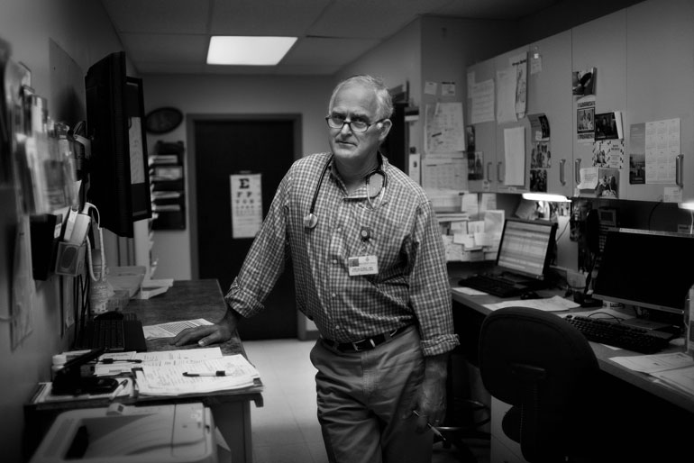 Dr. Tim Alford in his clinic in the central Mississippi town of Kosciusko. The hospital across the street has had to lay off staff and shutter its I.C.U. (Photo by Jon Lowenstein)