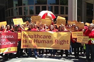 Members of the California Nurses Association rally in May in Sacramento (Photo by April Dembosky/KQED).