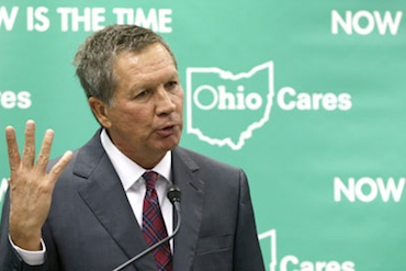 Ohio Gov. John Kasich speaks about Medicaid expansion at the Cleveland Clinic in October 2013. (AP Photo/Tony Dejak, File)
