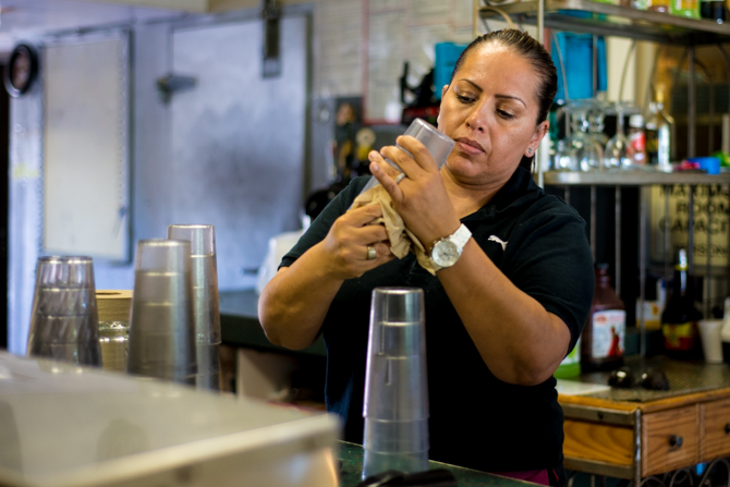 Sandra Lopez, 41, owner of Las Fajitas in Newport Beach, is a small business owner who has to make decisions about health insurance coverage for her family and business under the Affordable Care Act (Photo by Heidi de Marco/KHN).