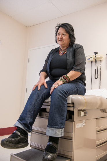 Teresa Martinez complains of leg pain from having to stand for long periods of time working as a hairdresser (Photo by Heidi de Marco/KHN).