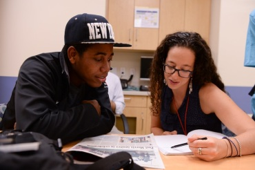 Terra Firma Coordinator Jenny Ajl reads with participant Yorby Lino at The Center for Child Health and Resiliency on Prospect Ave in the Bronx (Photo by Mark Bonifacio).