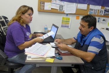 Enrollment counselor Norma Montenegro helps Alejandro Irigoyen, 45, sign up for a plan through Covered California. Irigoyen says he had never been covered before (Photo by Anna Gorman/KHN).