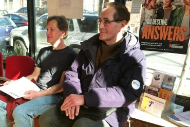 Jay Herskowitz, left and Joseph Krakauskas sought enrollment help at the Northern Liberties Community Center in Philadelphia Saturday. Krakauskas was first to arrive, an hour early (Photo by Alana Gordon/WHYY).