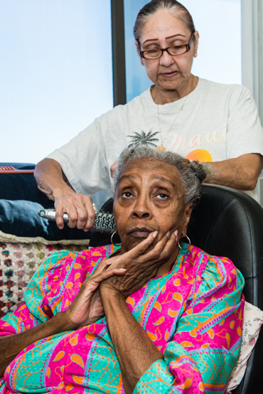 Maggie Belton suffers from arthritis and diabetes. The 82-year-old gets in-home care from Armida Pineda, 64, at her Pasadena apartment (Photo by Heidi de Marco/KHN).