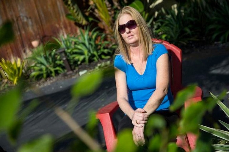 Malissa Miller applied for disability and was placed in the state's new privatized, Medicaid managed care system, which offers different plans depending on your county of residence. But none of the Medicaid plans offered in Broward County, where Miller lives, allowed her to see the doctor she believed could save her life (Photo by  Jon Durr/Miami Herald).