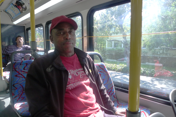 Leaburn Alexander works two jobs and does not have health insurance. Here, he is on the start of his 3-hour commute home from the job he works as an overnight hotel janitor. (Lisa Morehouse/KQED)