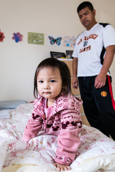 Jack Liu, 45, watches over three-year-old daughter Fiona Liu on Saturday, December 6, 2014. The Liu's decided he would stay home to take care of the children instead of paying for daycare (Photo by Heidi de Marco).