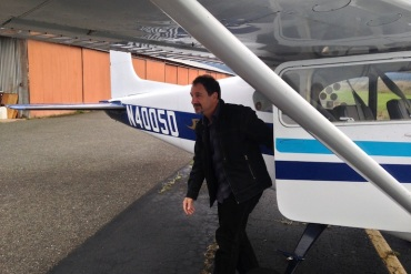 Palliative medicine physician Michael Fratkin gets off a plane after visiting a patient on the Hoopa Valley Indian Reservation. He's recently launched a startup to support this kind of work (Photo by April Dembosky/KQED).