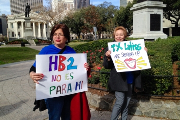Lucy Felix, left, and Celeste Martinez of Brownsville, Texas rally outside the Fifth Circuit Court of Appeals in New Orleans. The women oppose the controversial Texas abortion, House Bill 2, which was being reviewed Wednesday at the courthouse. (Photo by Carrie Feibel)