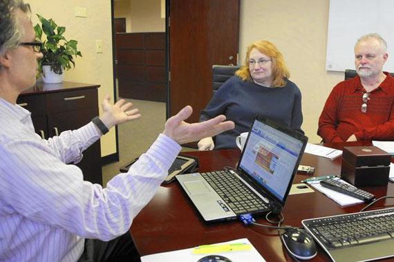 Naperville, Ill., insurance agent Robert Slayton talks to potential clients Jeanne and Ralph Wysocki on Jan. 8, 2015. (Photo by Chuck Berman/Chicago Tribune)