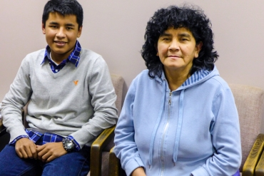 Daniel Palacios, 17, and his aunt, Lusmila Morales, 53, wait for enrollment assistance at Legal Services of Northern Virginia in Arlington, Va.  Morales, of Falls Church, Va., wants coverage so she can get a physical (Photo by Mary Agnes Carey/KHN).