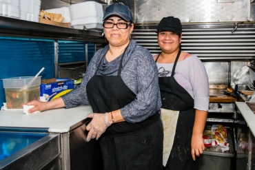 Elba Ramirez, 44, owner of Lily's Catering food truck and her cook Gladys Martinez, 39, at the end of their lunch shift (Photo by Heidi de Marco/KHN).