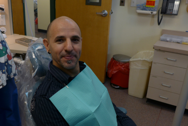 After snagging an appointment through a monthly lottery, Pavel Poliakov waits to see a dentist at the Health District of Northern Larimer County  clinic in Fort Collins, Colo. (Photo: Phil Galewitz/Kaiser Health News)