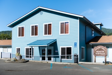 The clinic, a remodeled blue cottage, used to serve as the local forest service office (Photo by Heidi de Marco/KHN).