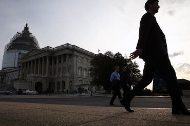 People walk past the U.S. Capitol Building on Thursday in Washington. (Photo by Mark Wilson/Getty Images)