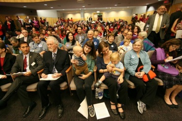 Anti-vaccine protesters gathered inside a hearing room in the Capitol building in Sacramento Wednesday, but the bill that would make it harder to opt out of immunizations passed the state Senate health committee. (Photo by Pauline Bartolone/Capital Public Radio)