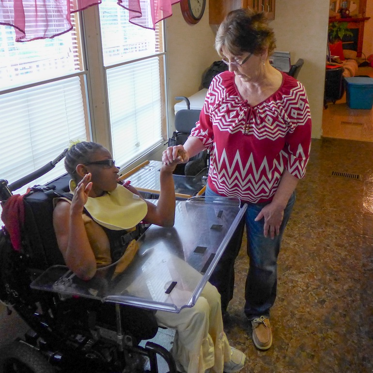 Charla Douglas, who had a bad experience with TennCare, and her adopted mom, Lynda Douglas (Photo by Jay Hancock/Kaiser Health News).