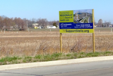 A sign marks the location of a proposed new St. Elizabeth's hospital in O'Fallon, Mo., on 114 acres of farmland just off Interstate 64. (Photo by Phil Galewitz/KHN)