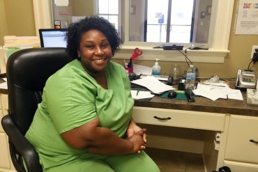 LaTasha Perry, 31, works at a community health center in Plaquemine, Louisiana.  Perry says getting insured under Obamacare was cheaper than paying the penalty (Photo by Jeff Cohen/WNPR).