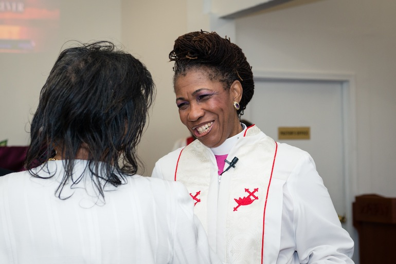 Bishop Gwendolyn Stone with a church member at the God Answers Prayer Ministries of Los Angeles on May 3, 2015 (Photo by Heidi de Marco/Kaiser Health News).