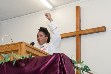Bishop Gwendolyn Stone at the God Answers Prayer Ministries of Los Angeles on May 3, 2015 (Photo by Heidi de Marco/Kaiser Health News).