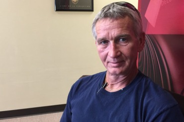 Jimmy See has had medical debt in the past, and he hopes insurance means he won't be in that position again. (Photo by Jeff Cohen/WNPR)