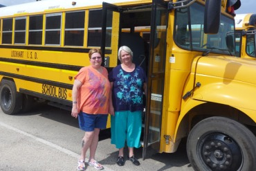 Billie Pender, a 58-year-old retired school bus driver and her sister,  Martha Sherwood, 62, who oversees Lockhart's school bus program. (Photo by Julie Appleby/KHN)