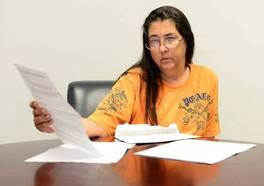 Kim Huggins' free coverage required her to cover a $5000 deductible. (Photo by Todd Sumin/Charlotte Observer)