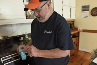 Danny Wilson, 60, checks out his medication at his home in Lizella on  June 4, 2015. He hoped to work until the day he died. Instead, he worked until a stroke last winter sidelined him from his job of 25 years. Now, Wilson is one of 430,000 Georgians who could lose the federal tax credits that allow them to be able to afford health insurance. (Photo by Hyosub Shin/Atlanta Journal-Constitution)