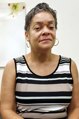 Renee Mitchell says even though she has health insurance she'll have trouble paying for the eye surgery she needs to save her vision. (Photo by Jim Burress/WABE)