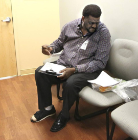 Vincent Adderly, 46, of Miami Gardens fills out forms in the medical records office at Memorial Hospital West in Pembroke Pines on Thursday, May 28, 2015. He is uninsured and diabetic and was at the hospital following his week- long hospitalization there. Part of the big toe on Adderly's right foot had to be amputated. (Photo by Marsha Halper/Miami Herald)