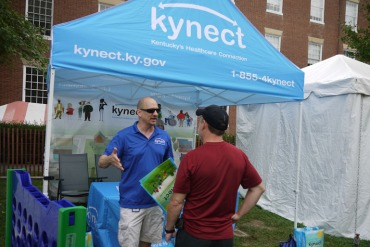 A Kynect booth at a festival in Bardestown, Ky., in 2013. Kynect, Kentucky's health exchange, has been successful even as enrollment there in the small business exchange lags. (Photo by Phil Galewitz/KHN)