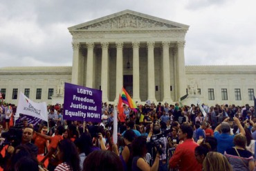 Demonstrators gather outside the Supreme Court Friday, June 26 after the court decided that same-sex couples around the nation could marry. (Photo by Alana Pockros/KHN)