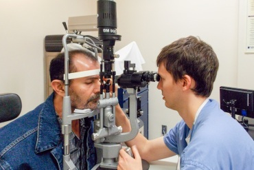 Patient Antonio Camargo gets an eye exam at the ophthalmology clinic at Los Angeles County Harbor-UCLA Medical Center on June 9, 2015. Camargo, 49, said he waited months for his first surgery, a corneal transplant, but his next operation happened within days. (Photo by Anna Gorman/KHN)