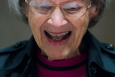 """Jean Altimont, 89, laughs during the """"Laugh Cafe"""" monthly group meeting at Sibley Memorial Hospital on Thursday, May 7, 2015 in Washington, D.C.  Seniors are invited to attend the cafe for the admission price of one joke. (Photo by Amanda Voisard/For the Washington Post)"""