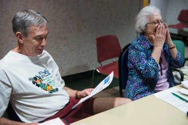 """Joanne Philleo, 79, right, laughs as Brad Bickford, 67, left, tells a joke during the """"Laugh Cafe"""" monthly group meeting at Sibley Memorial Hospital on Thursday, May 7, 2015 in Washington, D.C.  Seniors are invited to attend the cafe for the admission price of one joke. (Photo by Amanda Voisard/For the Washington Post)"""