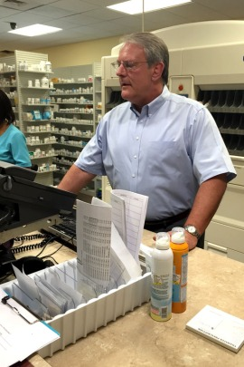 Pharmacist Bill Napier hired a lawyer to do criminal background checks on his painkiller patients to help him decide who to dismiss. (Photo by Jessica Palombo/For KHN)