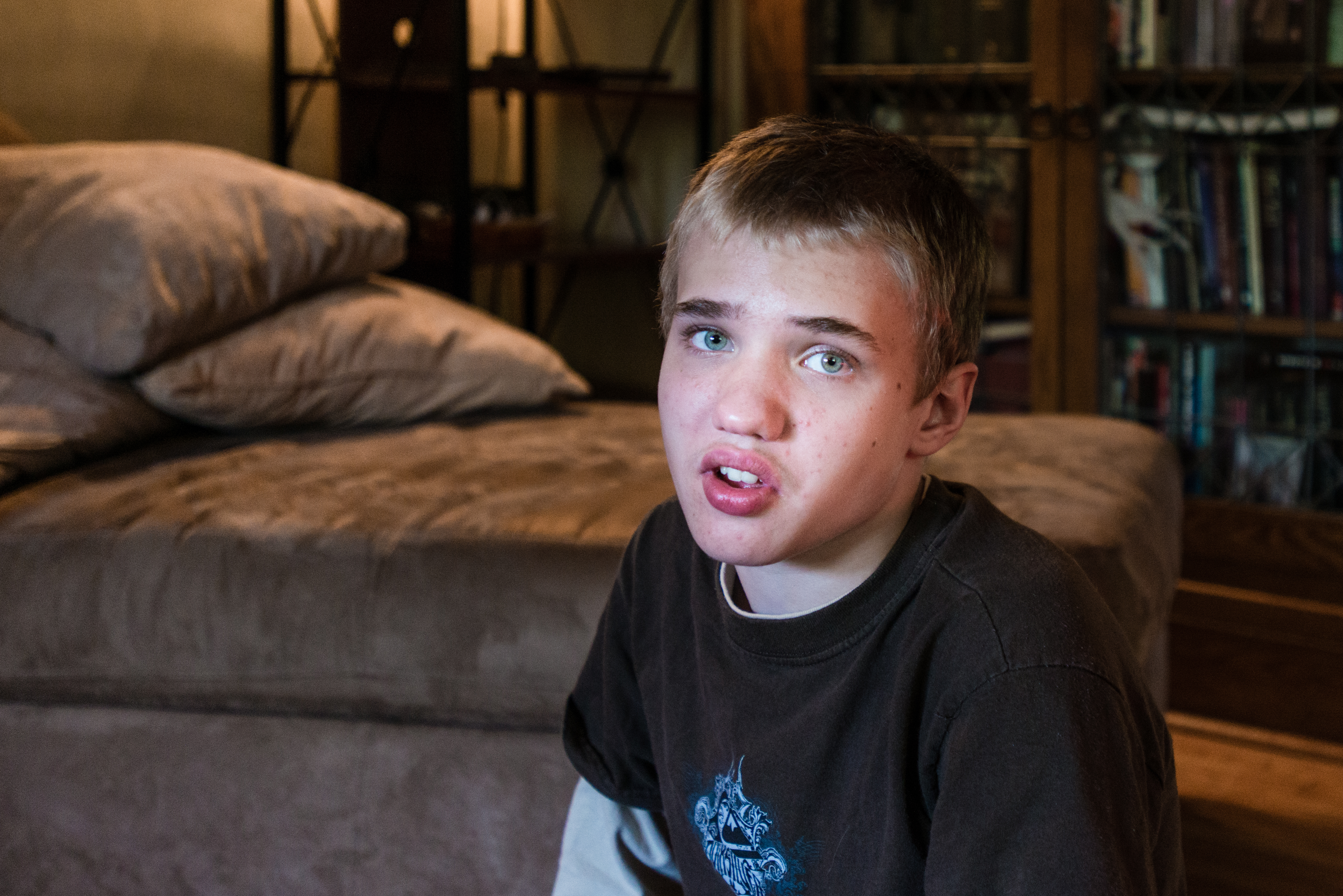 Alexander Brown, 14, sits in his living room on Thursday, May 14, 2015. He was diagnosed with autism at 18 months. Alexander is having a hard time with puberty and is lashing out physically (Photo by Heidi de Marco/KHN).