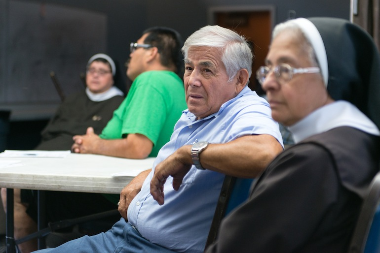 Community members share their concerns at Resurrection Catholic Church in East Los Angeles on Monday, September 14, 2015 (Photo by Heidi de Marco/KHN).