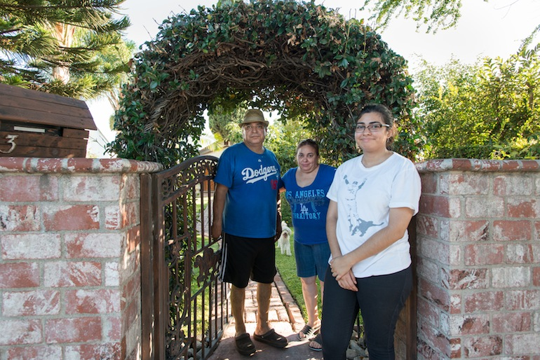 Jessica Prieto and her parents at their home in East Los Angeles on Sunday, September 20, 2015. The Prieto's live less than two miles from the Exide plant and are still waiting for their home to be inspected for contamination (Photo by Heidi de Marco/KHN).