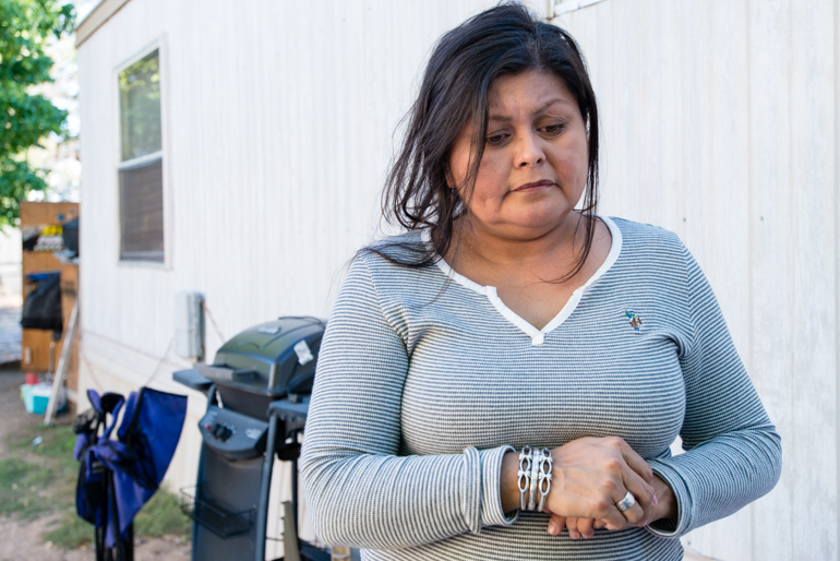 Rochelle Jake, 45, at her home in Albuquerque, New Mexico on Monday, August 3, 2015. As a member of the Navajo tribe, Jake says she thought the Indian Health Service should be responsible for her health care, not Obamacare (Photo by Heidi de Marco/KHN).