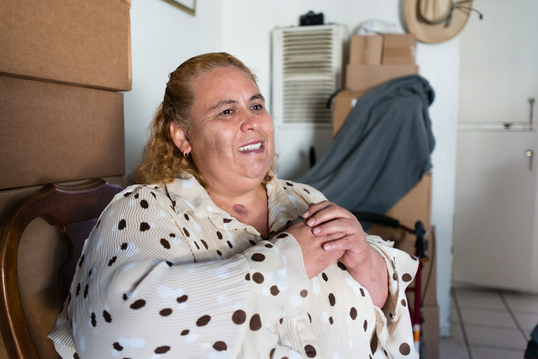 Patient Maria Rivera, 48, at her home in La Puente, California, on Friday, October 9, 2015. Rivera is diabetic, dealing with high blood pressure and recently had a tracheotomy (Photo by Heidi de Marco/KHN).