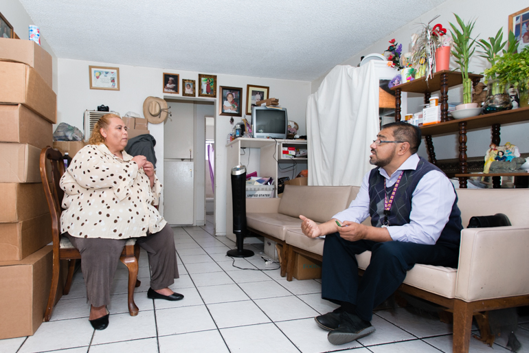 Walfred Lopez, a community health worker at the Los Angeles County-USC Medical Center, visits patient Maria Rivera, 48, at her home in La Puente, California, on Friday, October 9, 2015. Rivera says she depends on Lopez to understand what is happening with her health (Photo by Heidi de Marco/KHN).
