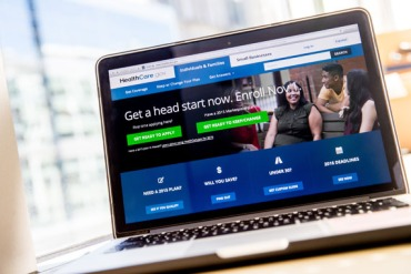 The healthcare.gov website, where people can buy health insurance, is displayed on a laptop screen. (Photo by Andrew Harnik/AP)