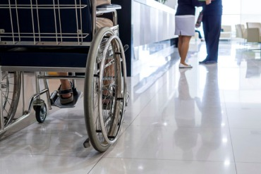Closeup of elderly man on wheelchair in hospital