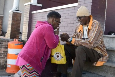 Sharlene Adams bought one cigarette from a neighbor as she waited for a bus. (Capital News Service/Rachel Bluth)