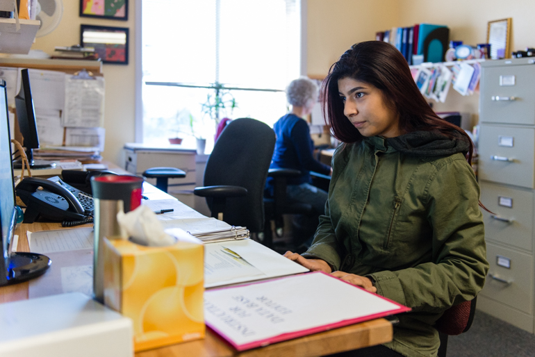 Nubia Flores Miranda, 18, works part-time at Family Paths, a counseling and mental health organization in Oakland, Calif., on Friday, January 29, 2016. Miranda said she became interested in a career in mental health after she started experiencing depression and anxiety her freshman year at Life Academy of Health and Bioscience. (Heidi de Marco/KHN)