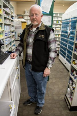At Richard Logan's pharmacy in Charleston, Mo., prescription opioid painkillers are locked in a cabinet. For 20 years, he's also been a reserve deputy with two local sheriff's departments, investigating prescription drug abuse. Bram Sable-Smith/Side Effects Public Media/KBIA